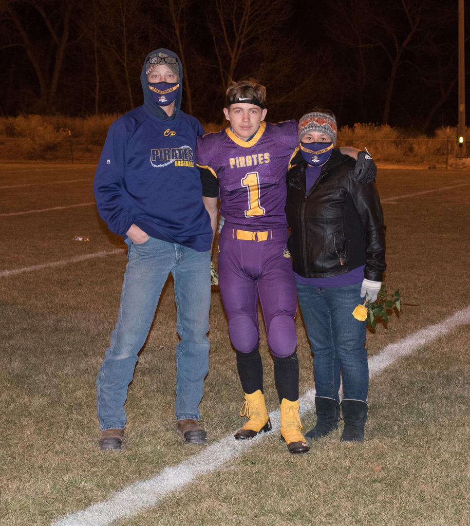 Parents and football player